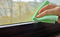 Cleaning water  condensation on window Royalty Free Stock Photo