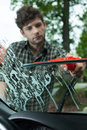 Cleaning windscreen in a car man vertical Stock Photos