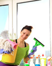 Cleaning woman a with various products and tools washing a window Royalty Free Stock Photography