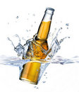 Clear Beer bottle falling into water. Stock Photos
