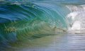 Clear blue barreling surf photograph of a smooth glassy beach break wave Stock Images