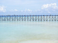 Clear blue sea, sky, white clouds and wooden bridge Royalty Free Stock Photo