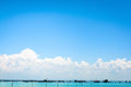 Clear blue sky and white clouds with seascape