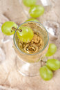 Clear drink with grapes, top view Royalty Free Stock Photo