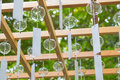 Clear glass wind chimes hang from wood structure during Wind Chi Royalty Free Stock Photo