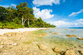 Clear ocean water exposes rocks low tide pristine undeveloped stretch white sand beach neil island andaman nicobar islands india Stock Image