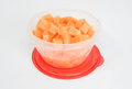 Clear plastic bowl chopped canteloupe red lid Royalty Free Stock Photo