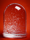 Clear plastic snow globe floating snow particles red background Stock Photography