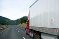 Clear red big rig semi truck white dry van trailer in perspectiv Royalty Free Stock Photo