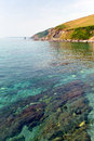 Clear sea in cornwall england at portwrinkle whitsand bay Stock Photos