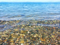 Clear sea water horizontal photo of a clean and transparent pebbles and stones are visible in the Royalty Free Stock Photography