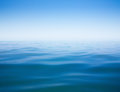 Clear sky and calm sea or ocean water surface Royalty Free Stock Photo