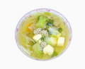 Clear soup with bean curd and minced pork in dish on white backg background photo Stock Photo