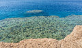 Clear turquoise sea with corals and reefs on a summer day Royalty Free Stock Photo