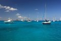 Clear water, island, boats and yachts Stock Image