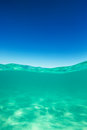 Clear waterline caribbean sea underwater and over with blue sky Royalty Free Stock Photo