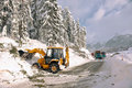 Clearing roads of snow and fallen tree Royalty Free Stock Images