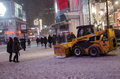 Clearing snow in the sidewalk in toronto december downtown during a snowfall is canada s largest city and Royalty Free Stock Photography