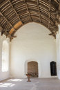 Cleeve abbey somerset england interior of a medieval hall in in detail of wooden timber carved ceiling and stone whitewashed walls Stock Photos