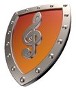 Clef on metal shield Stock Images