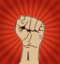 Clenched fist held high a in protest or solidarity Royalty Free Stock Images