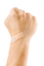 Clenched a fist with plaster Royalty Free Stock Photo