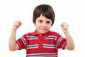 Clenched fists winning child with studio shot Royalty Free Stock Photo