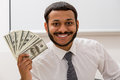 Clerk received a salary manager keeps the dollars in hand Stock Photos