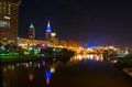 Cleveland aglow oh may view of s riverfront with colorful terminal tower and quicken loans arena the q the site of the nba Stock Images