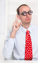 Clever businessman like a comedian or an officials give an advic warning angry with red tie showing with his index finger looking Stock Photos