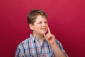 Clever fellow thoughtful boy portrait of with red background Stock Photos