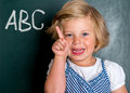 Clever girl in front of black board Stock Photography