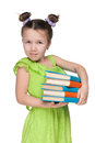 Clever little girl with books a portrait of a against the white background Royalty Free Stock Image