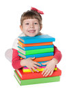 Clever little girl near books a smiling is sitting on the floor the pile of on the white background Stock Photography