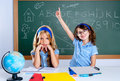 Clever nerd student girl in classroom raising hand Stock Photography