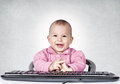 Clever plan a baby with a smile comes up with a Stock Photography