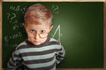 Clever pupil boy in eyeglasses near schoolboard green Royalty Free Stock Photography