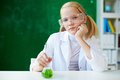 Clever schoolgirl portrait of cute sitting at workplace with chemical liquid in front Stock Photography