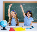 Clever students in classroom raising hand Stock Photography
