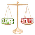 Clever vs stupid words scale fine line humor taste is a joke funny or offensive or is the question being weighed and compared on Stock Photo