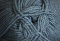 Clew of woolen yarn grey closeup Stock Photography