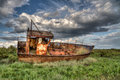 Cley wreck steel boat at norfolk uk Stock Image