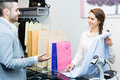 Client paying for new apparel at store positive smiling customer counter Royalty Free Stock Image