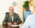 Client talking with notary happy manager at s office Royalty Free Stock Photos