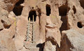 Cliff cave dwellings with ladder along the canyon at bandelier national monument in new mexico Stock Photography