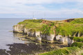 Cliff formations at flamborough head yorkshire with distant figures england Royalty Free Stock Photo