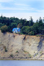 Cliff house view an island standing just steps from the edge of a steep a forest in the background a steep beach and Royalty Free Stock Image