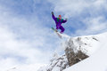 Cliff jump awesome snowboarder jumps of a in les portes du soleil in france Royalty Free Stock Photo
