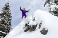 Cliff jump snowboard awesome snowboarder is having fun in the backcountry powder of les portes du soleil in france Royalty Free Stock Images