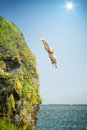 Cliff jumper an image of a at the sea Stock Images
